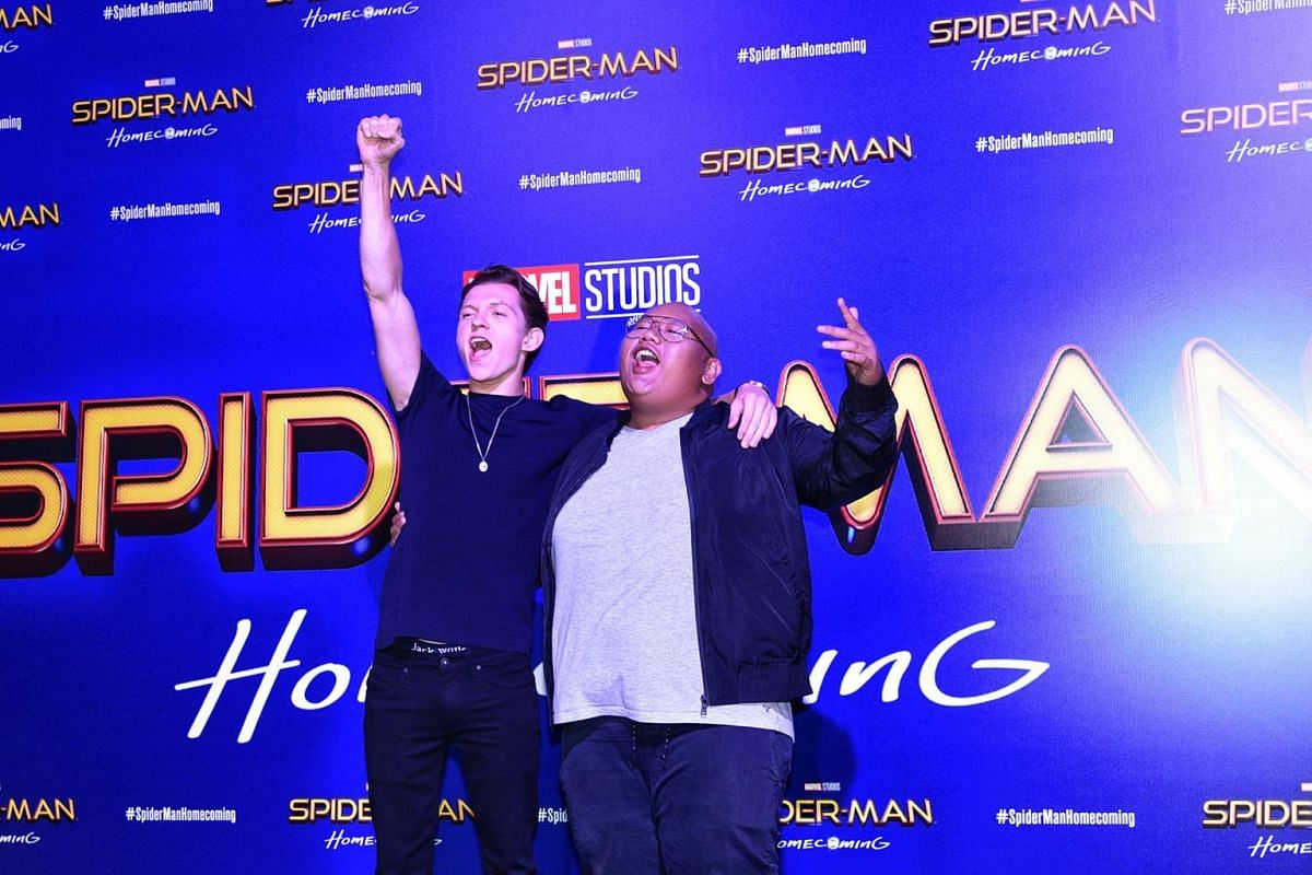 Tom Holland (left) and Jacob Batalon greeting the fans at the Spider-Man movie red carpet.