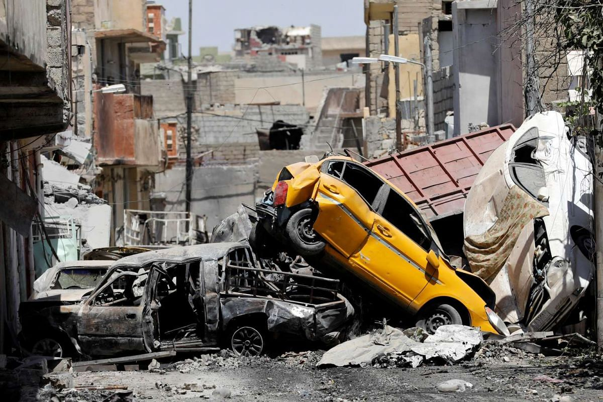 Vehicles piled on top of each other are seen at the site of fighting between the Iraqi forces and Islamic State militants in Mosul's al-Zanjili's district, Iraq June 7, 2017. PHOTO: REUTERS