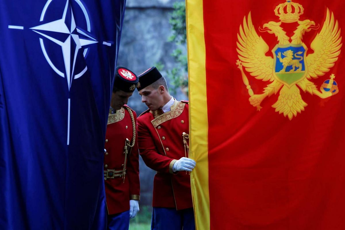 Montenegrin guard of honor inspect NATO and Montenegro flags prior to a ceremony to mark the accession to NATO of Montenegro in Podgorica, Montenegro, June 7, 2017. PHOTO: REUTERS