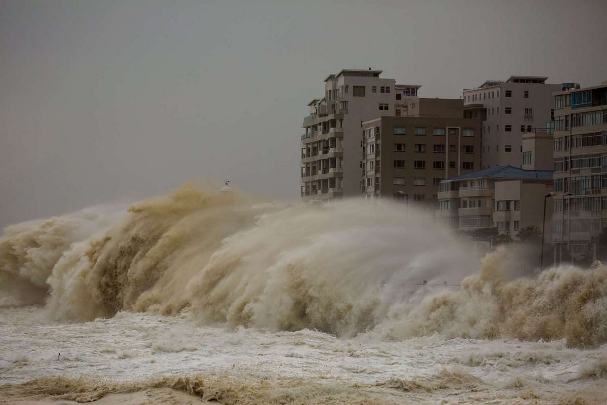 Waves crash over the Seapoint promenade during a storm in Cape Town, South Africa on June 7, 2017.