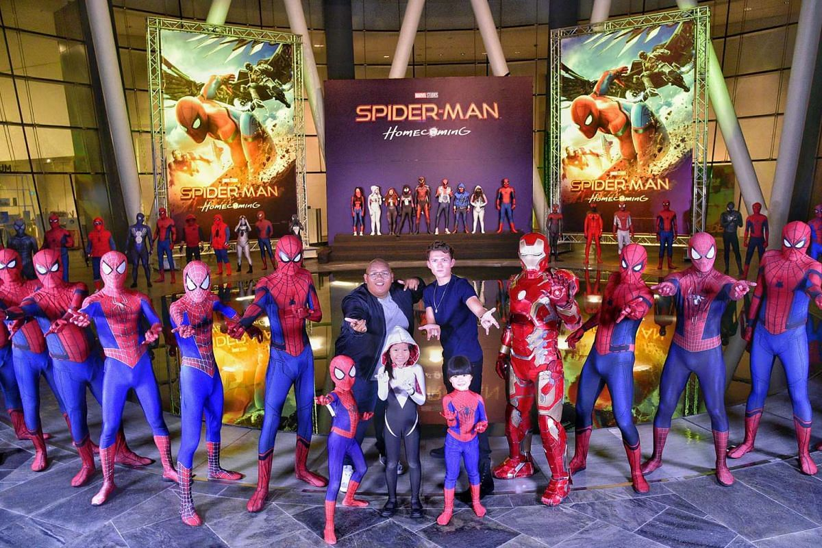 The stars of upcoming movie Spider-Man: Homecoming Jacob Batalon (centre left) and Tom Holland posing with costumed Spider-Man fans after the closed-door, red-carpet event for the movie at ArtScience Museum, June 7, 2017. PHOTO: THE STRAITS TIME/DESM