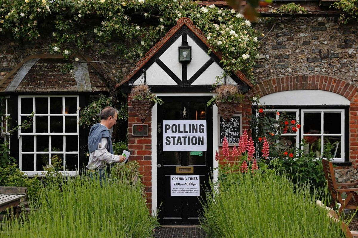A man arriving to cast his ballot at a pub, set up as a Polling Station, in Christmas Common, near Oxford, west of London, on June 8, 2017.