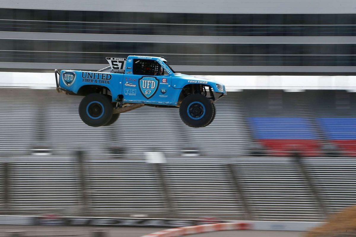 Drew Davison of Star-Telegram participates in Speed Energy Super Trucks ride-alongs with former NASCAR/INDYCAR star Robby Gordon at Texas Motor Speedway on June 7, 2017 in Fort Worth, Texas. PHOTO: GETTY IMAGES/AFP