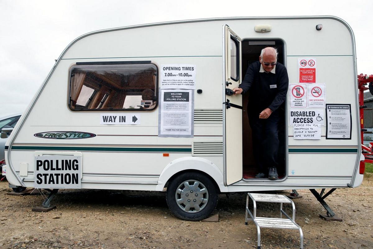 A voter leaving a polling station in Garthorpe, Britain on June 8, 2017.