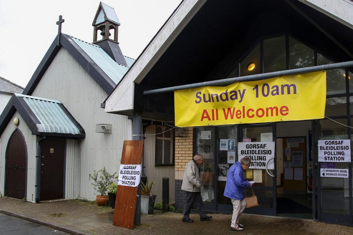 People arriving at a polling station in Cardiff, Wales, on June 8, 2017.