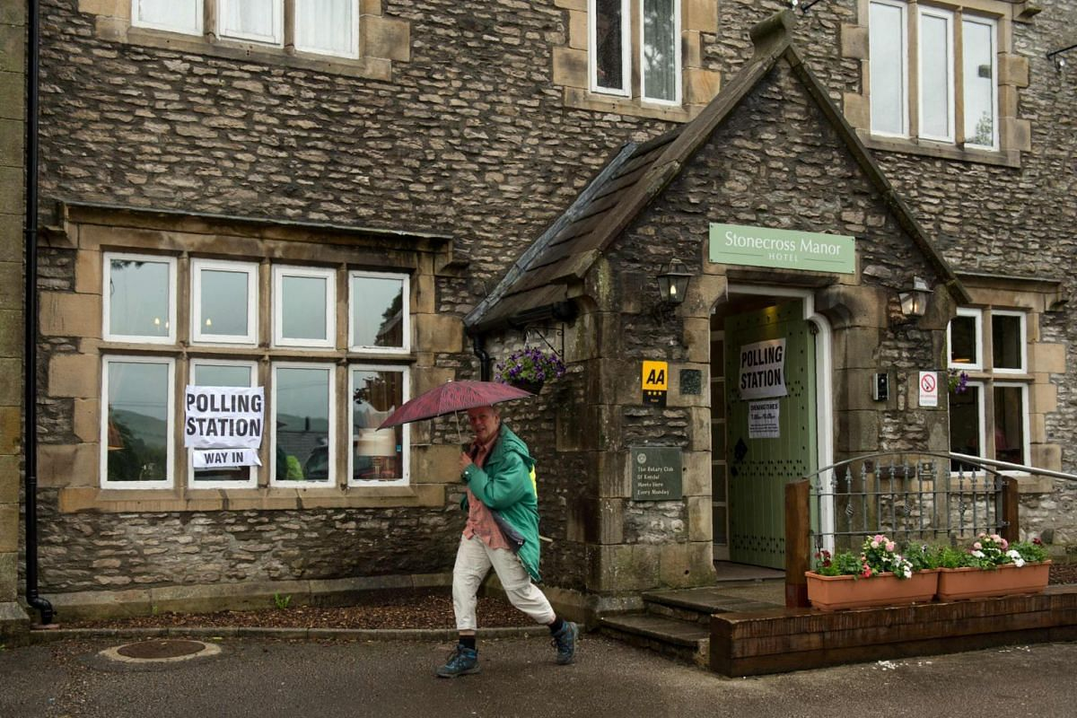 A man leaving a polling station in the Stonecross Manor Hotel in Kendal, north-west England, on June 8, 2017.