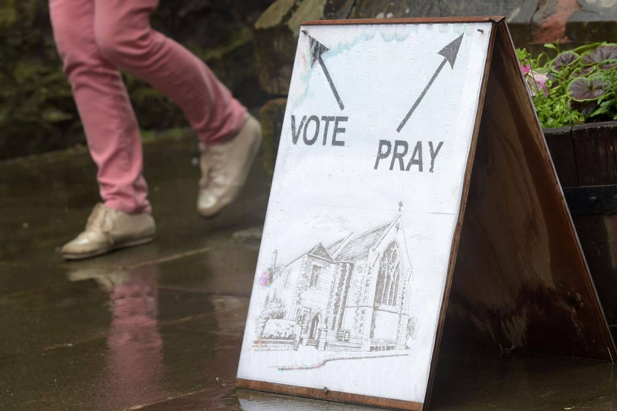 A sign is pictured at a polling station at St James Church in Edinburgh, Scotland, on June 8, 2017.