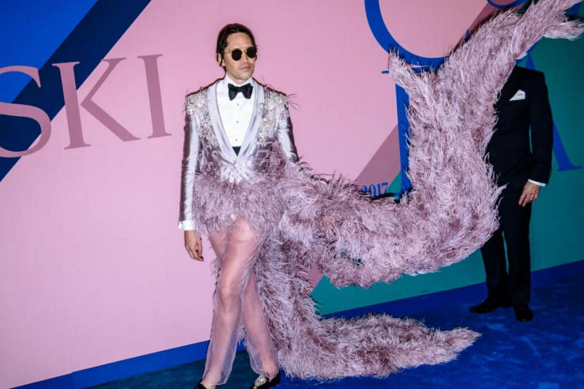 Edmundo Huerta, aka Di Mondo,  in what was likely the most eye-catching outfit of the evening - a tuxedo that got eaten by a pink sequinned flamingo.