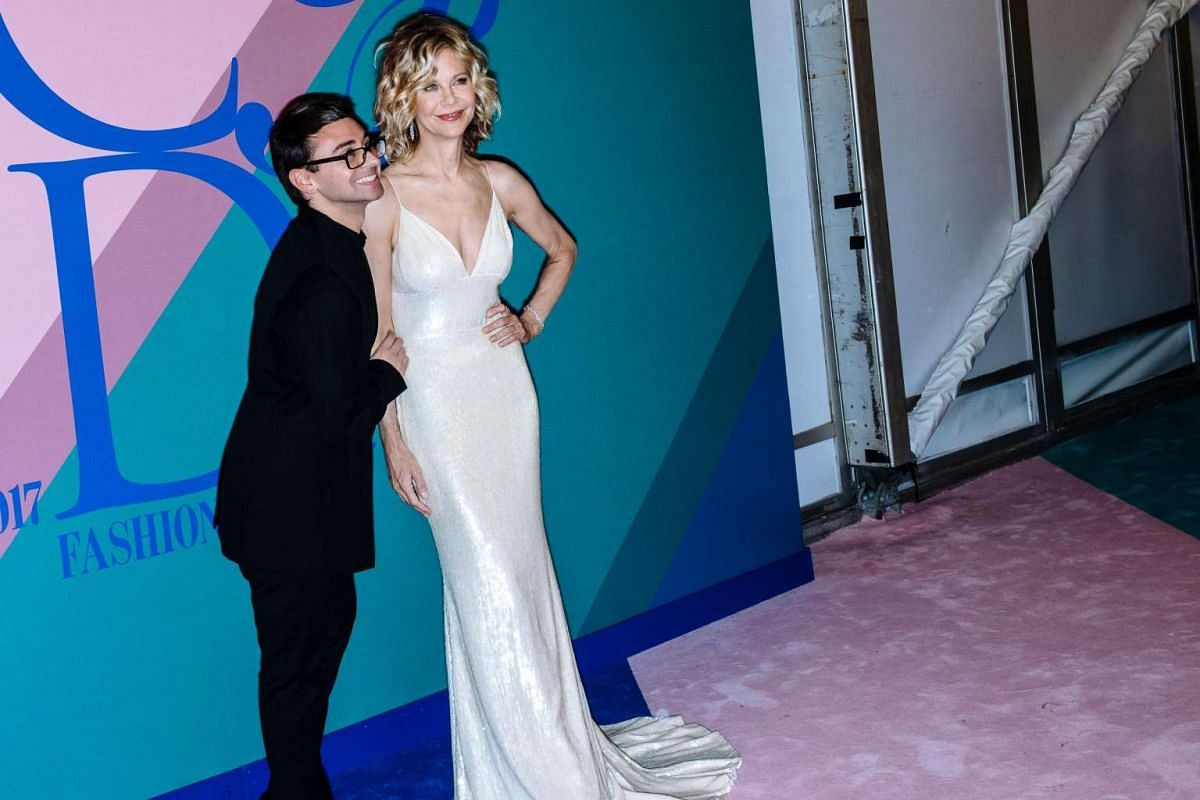 Designer Christian Siriano and actress Meg Ryan pose for the cameras.