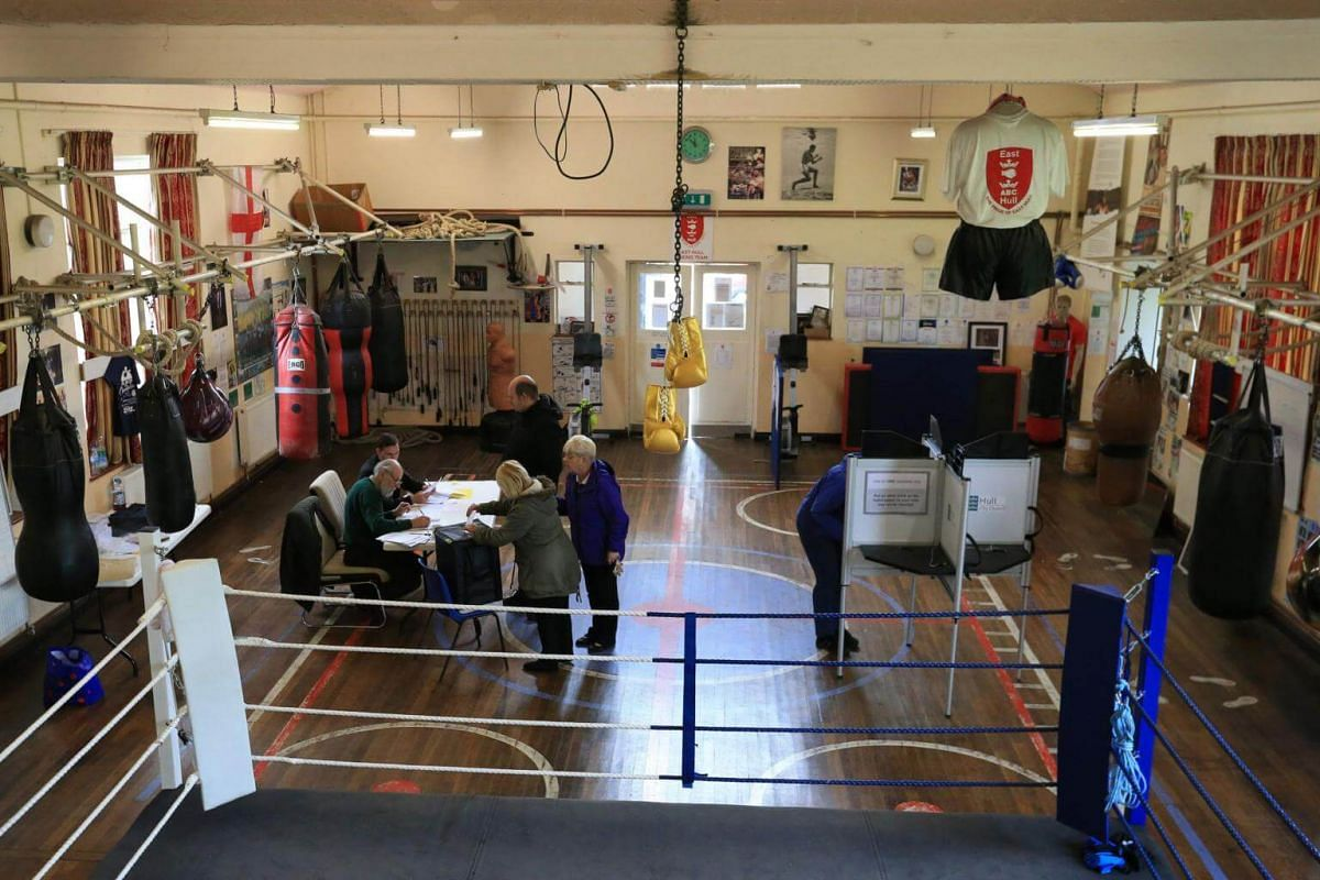 People voting at the East Hull Boxing Club set up as a polling station in Kingston-Upon-Hull, northern England, on June 8, 2017.