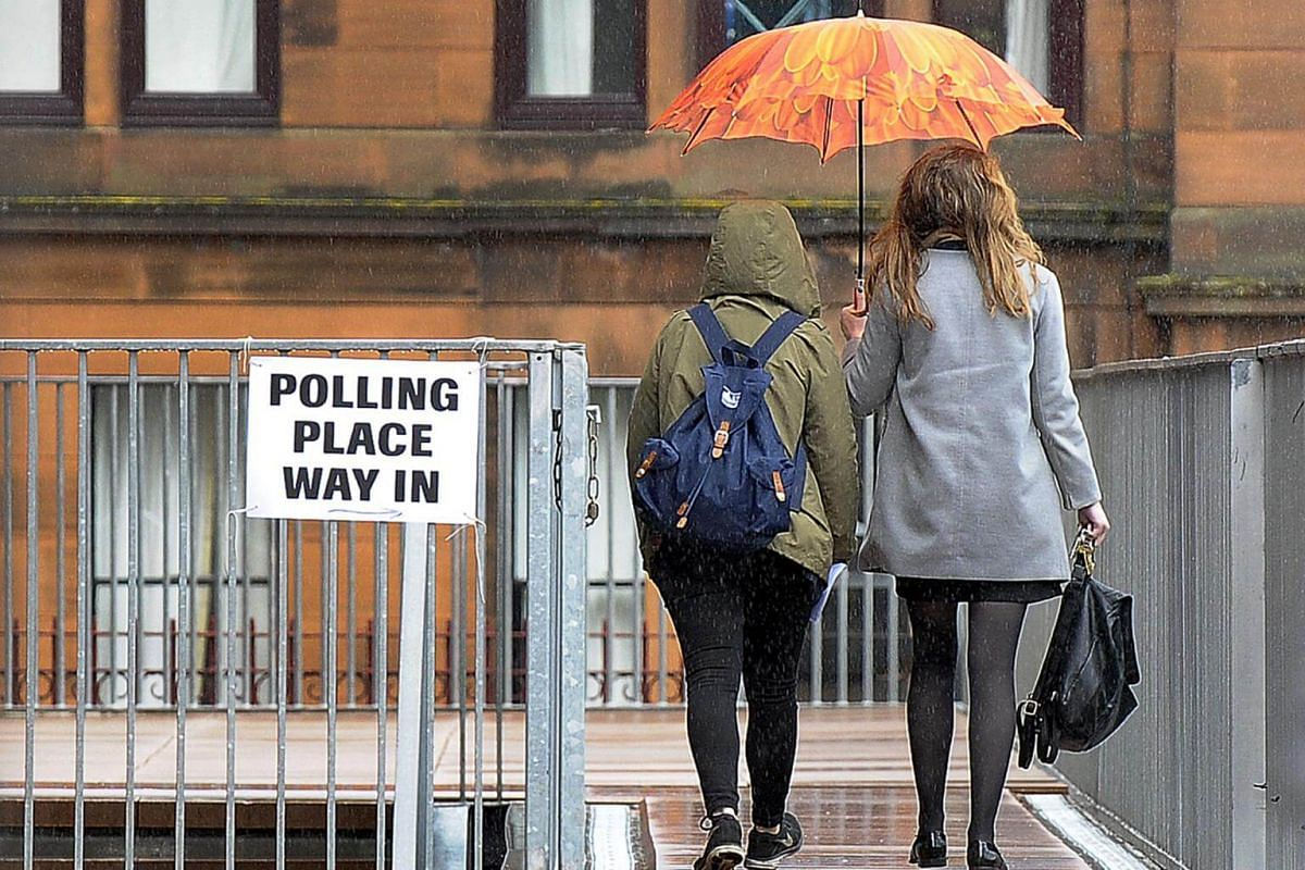 Voters arriving at Notre Dame Primary School set up as a polling station in Glasgow on June 8, 2017.