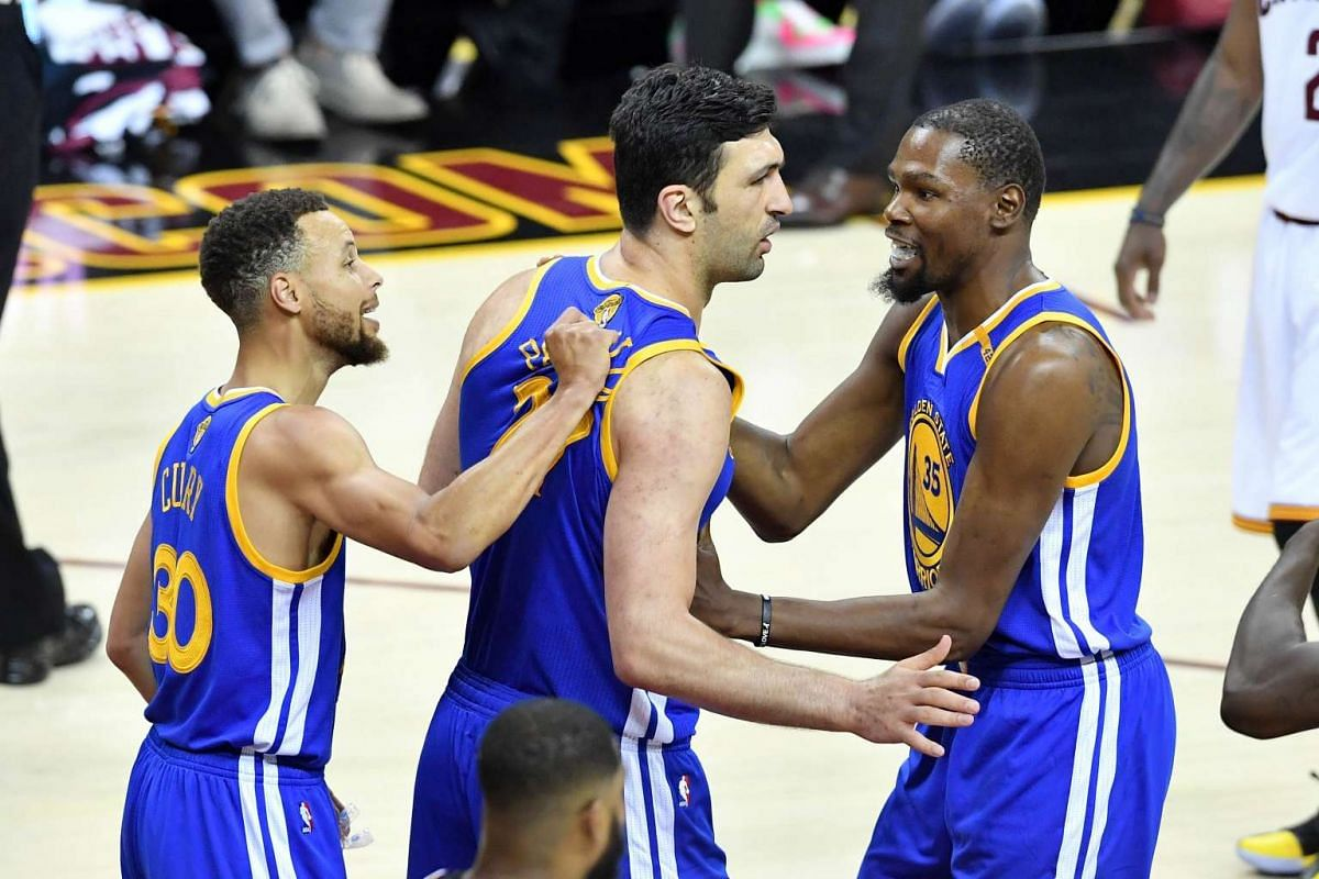 Stephen Curry (30), Zaza Pachulia (27) and Kevin Durant  (35) of the Golden State Warriors react after a play in the first half against the Cleveland Cavaliers.