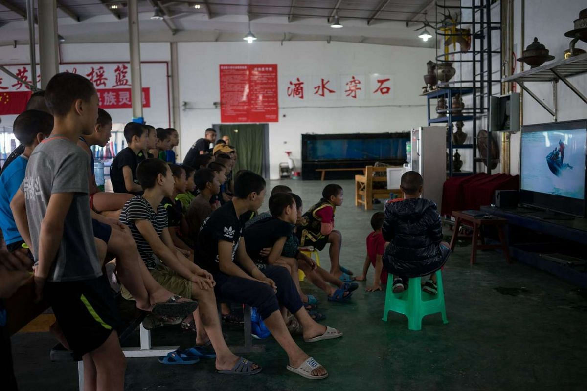 Trainees watch videos on the TV during a break between the morning and afternoon training sessions, on May 26, 2017.