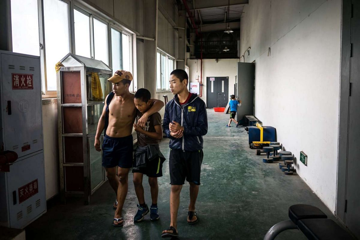 Xi Xiao Jun (left), Rang Bo (centre) and Luo Wu Zhan Deng exit the gym after their morning training, on May 24, 2017.
