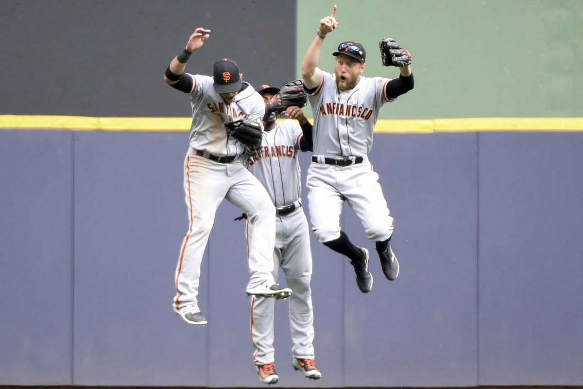 San Francisco Giants left fielder Gorkys Hernandez (66), center fielder Denard Span (2) and right fielder Hunter Pence (8) celebrate after beating the Milwaukee Brewers in ten inning at Miller Park on June 8, 2017. PHOTO: USA TODAY SPORTS