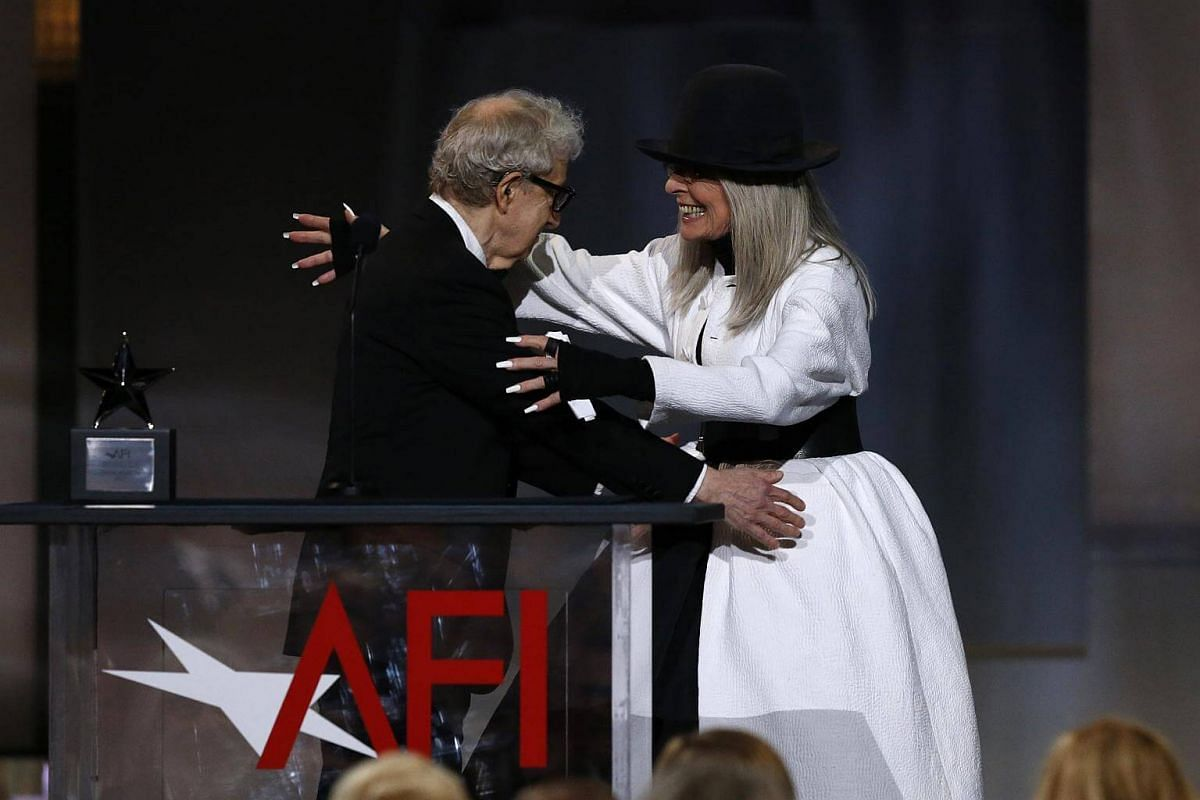 Actress Diane Keaton embracing director Woody Allen as she arrives on stage to receive an award in her honour.