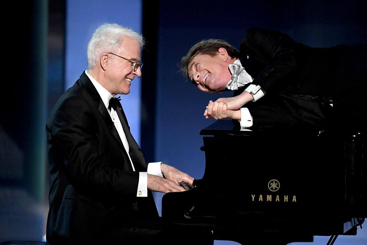 Actors Steve Martin (left) and Martin Short performing onstage during American Film Institute's 45th Life Achievement Award Gala Tribute to Diane Keaton at Dolby Theatre in Hollywood, California on June 8, 2017.