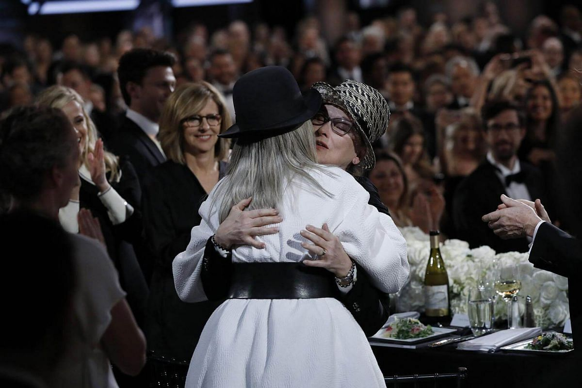 Actresses Meryl Streep (right) and Diane Keaton embracing.