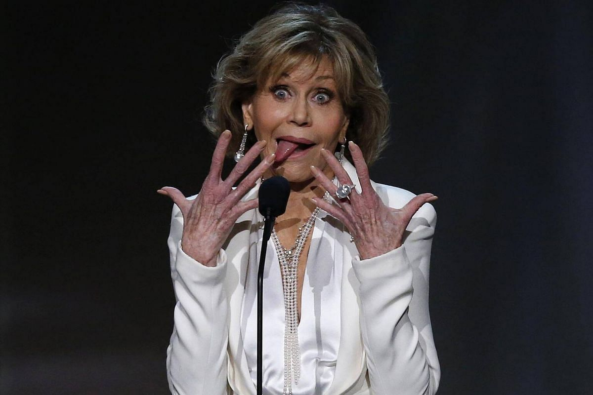 Actress Jane Fonda makes a face as she speaks on stage.