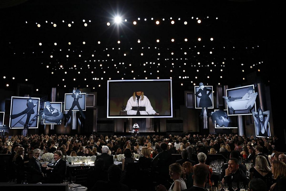 Actress Diane Keaton speaking on stage as she receives an award in her honour.