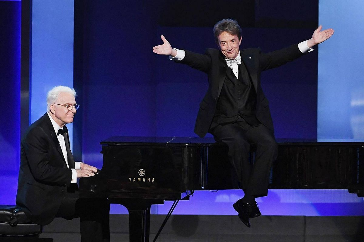 Actors Steve Martin (left) and Martin Short performing onstage during American Film Institute's 45th Life Achievement Award Gala Tribute to Diane Keaton at Dolby Theatre in Hollywood, California, on June 8, 2017.