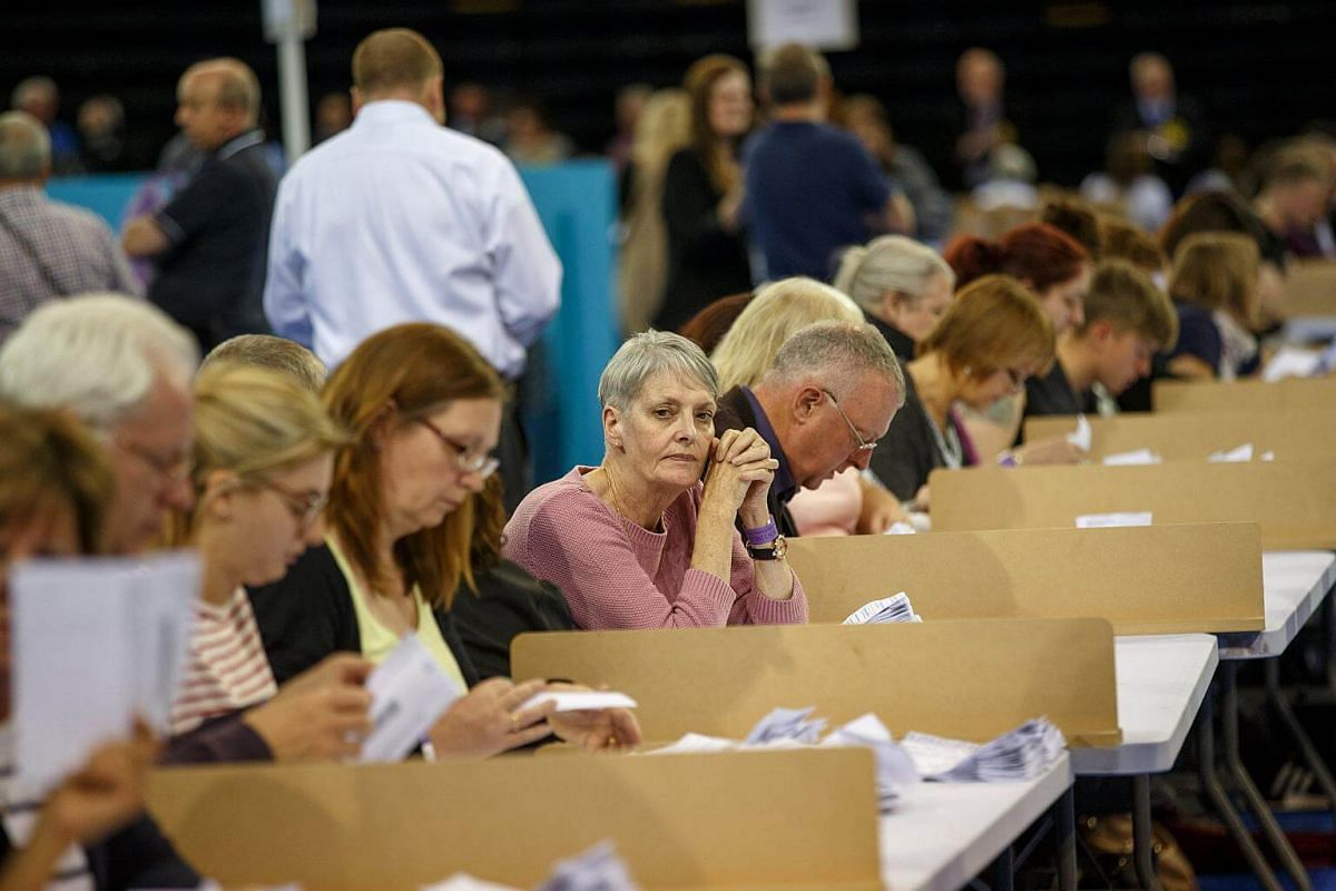 Election officials counting votes in the Emirates Arena in Glasgow, Scotland, Britain, on June 8, 2017.