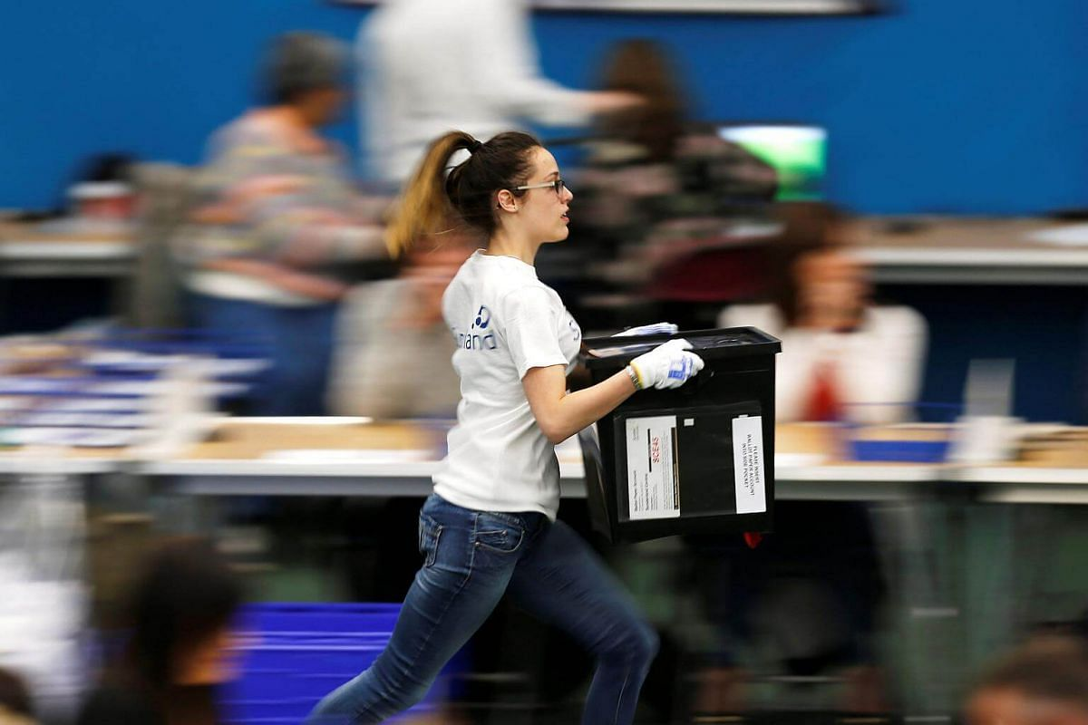A ballot box is rushed into the counting centre for Britain's general election in Sunderland, on June 8, 2017.
