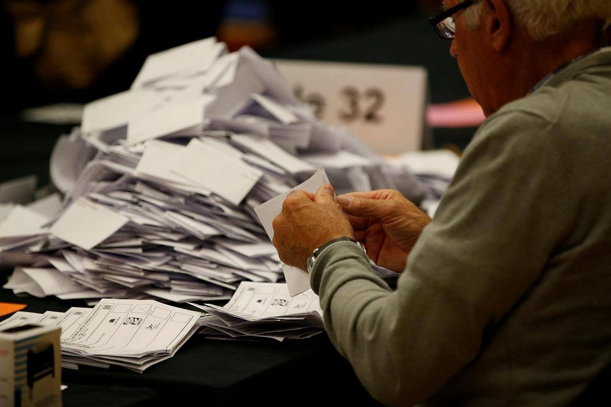 Ballots are counted at a counting centre for Britain's general election in Kendal, on June 8, 2017.