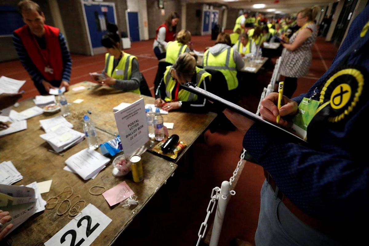 A Scottish National Party activist watching as ballots are tallied at a counting centre for Britain's general election in Edinburgh, on June 8, 2017.