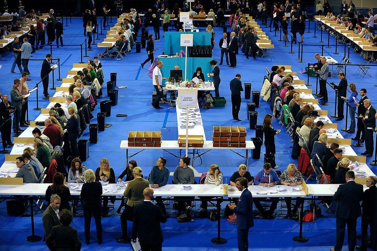 Counting staff counting ballots at the main Glasgow counting centre in Emirates Arena in Glasgow, Scotland, on June 8, 2017.