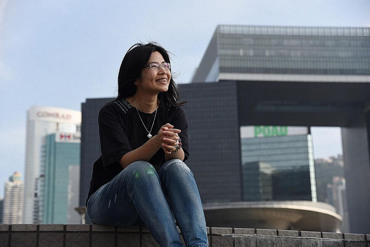 Ms Iris Tong, 46, a freelance journalist.