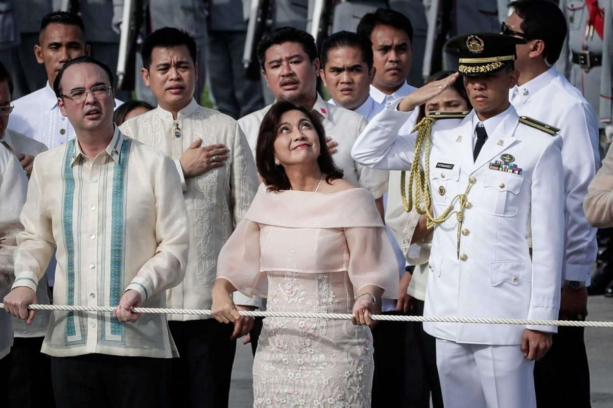 Philippines Vice-President Leni Robredo (centre) and Foreign Affairs Secretary Alan Peter Cayetano (left) participate in the flag raising during ceremonies marking Independence Day at Luneta Park in Manila, Philippines on 12 June 2017.