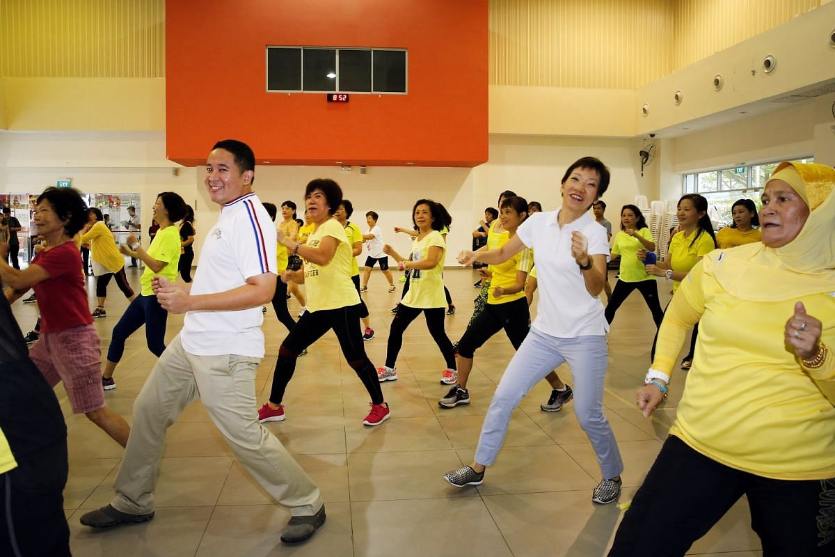 Minister for Culture, Community and Youth Grace Fu (in white top) and grassroots adviser and MP for the area Mr Amrin Amin, joining residents in morning exercises at the Woodlands Galaxy Community Club on June 11, 2017.