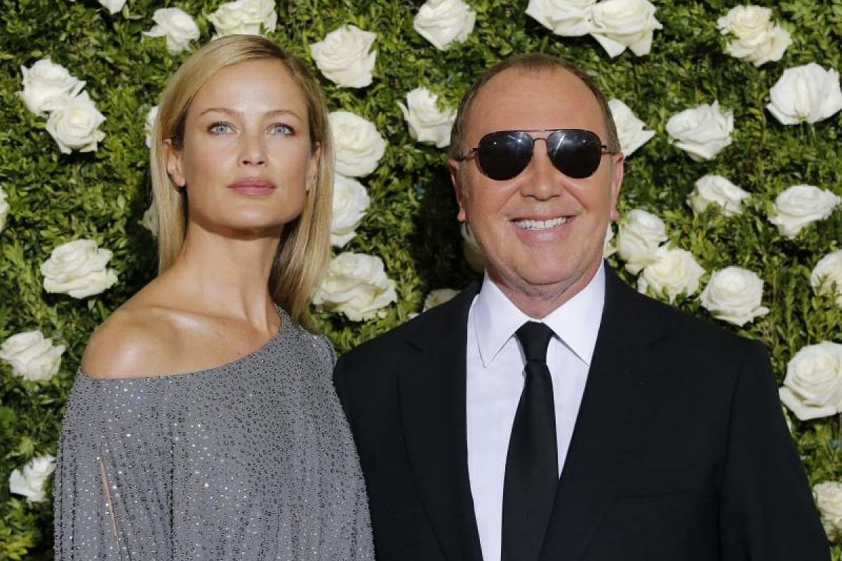 Fashion designer Michael Kors (right) and actress and model Carolyn Murphy.