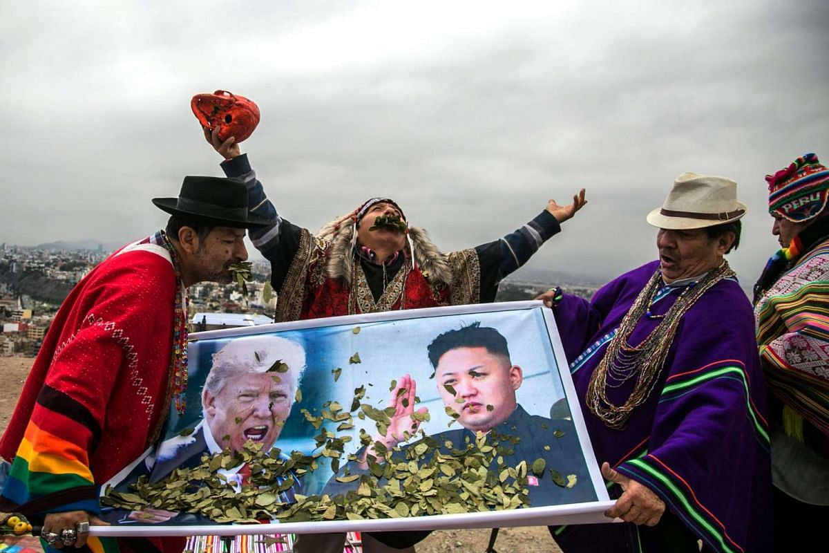 Shamans perform a ceremony asking for world peace in Lima, Peru, June 12, 2017. The shamans carried billboards with pictures of US President Donald Trump and North Korean leader Kim Jong-un. They also included Venezuela in their ritual, and asked for