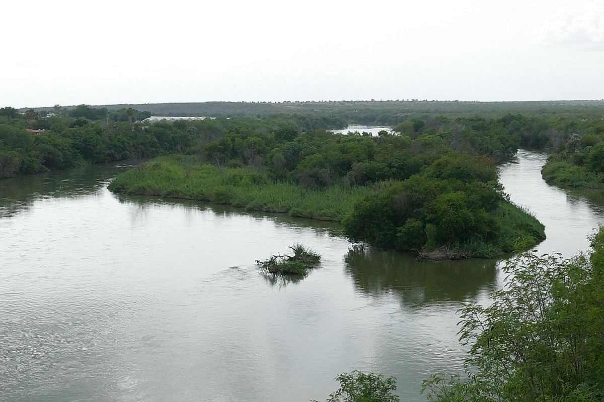 (Above) The wall would have to be built on the American side of the Rio Grande river, which means it will slice through privately owned land. (Left) A rope ferry at the town of Los Ebanos in Texas that plies both sides of the river.