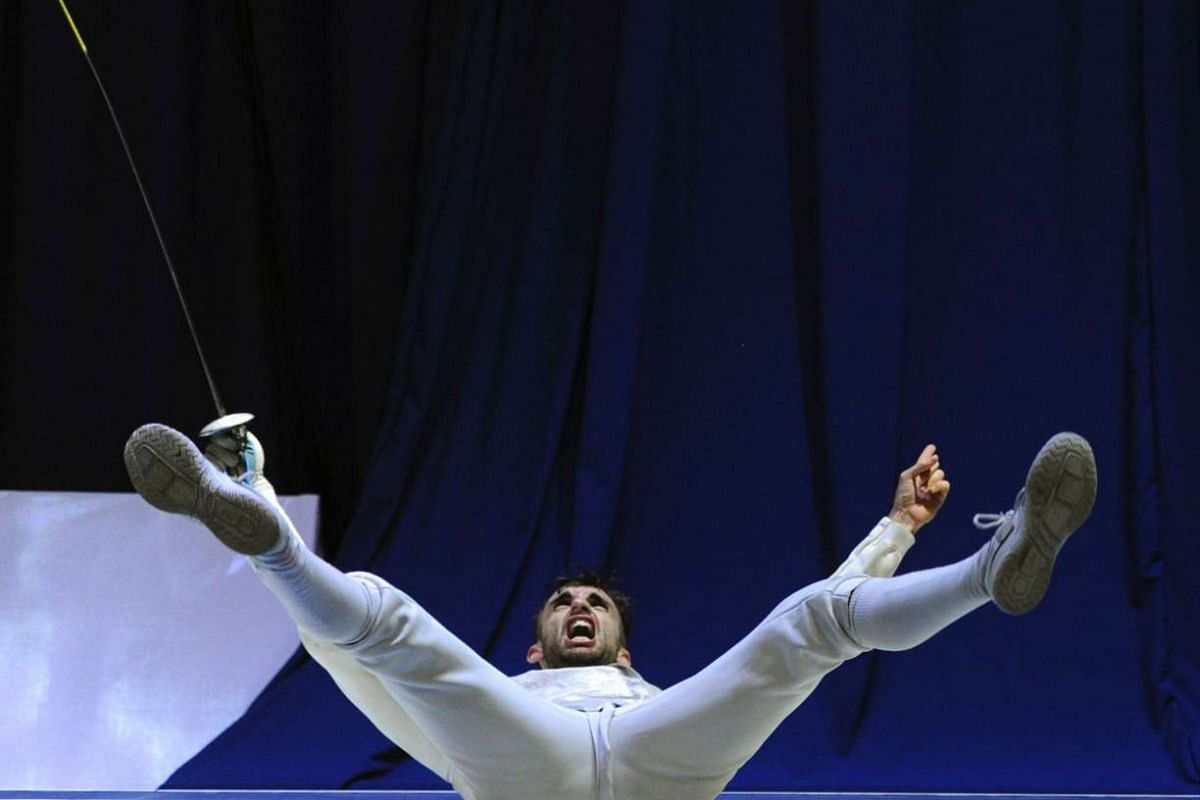 Italy's Daniele Garozzo reacts after winning the gold medal in the men's individual Foil competition at the European Fencing Senior Championships in Tbilisi on June 12, 2017.