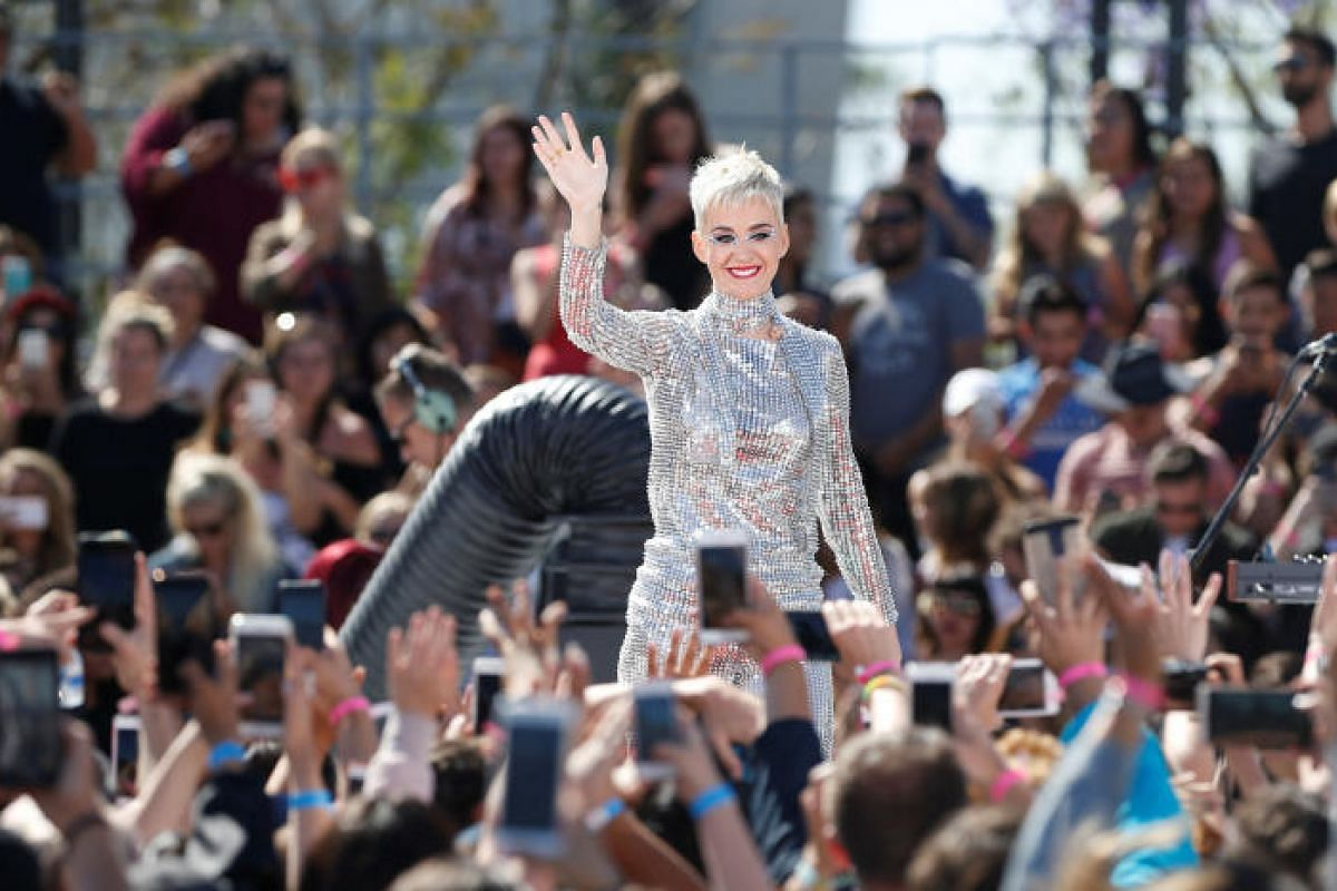 Singer Katy Perry waving to her fans.