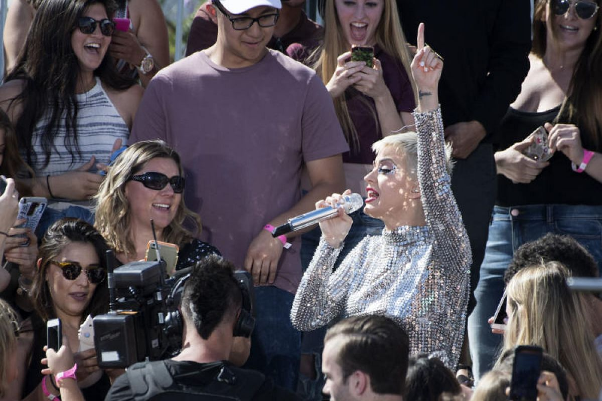 Singer Katy Perry getting up close and personal with the crowd.