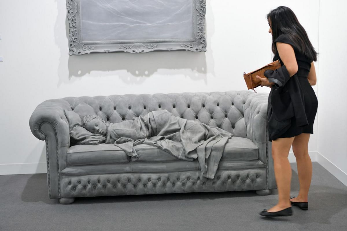 Sleeping Girls by Belgian visual artist Hans Op de Beeck is displayed at Galerie Krinzinger's stand during the preview day of Art Basel the world's premier modern and contemporary art fair on June 13, 2017 in Basel.