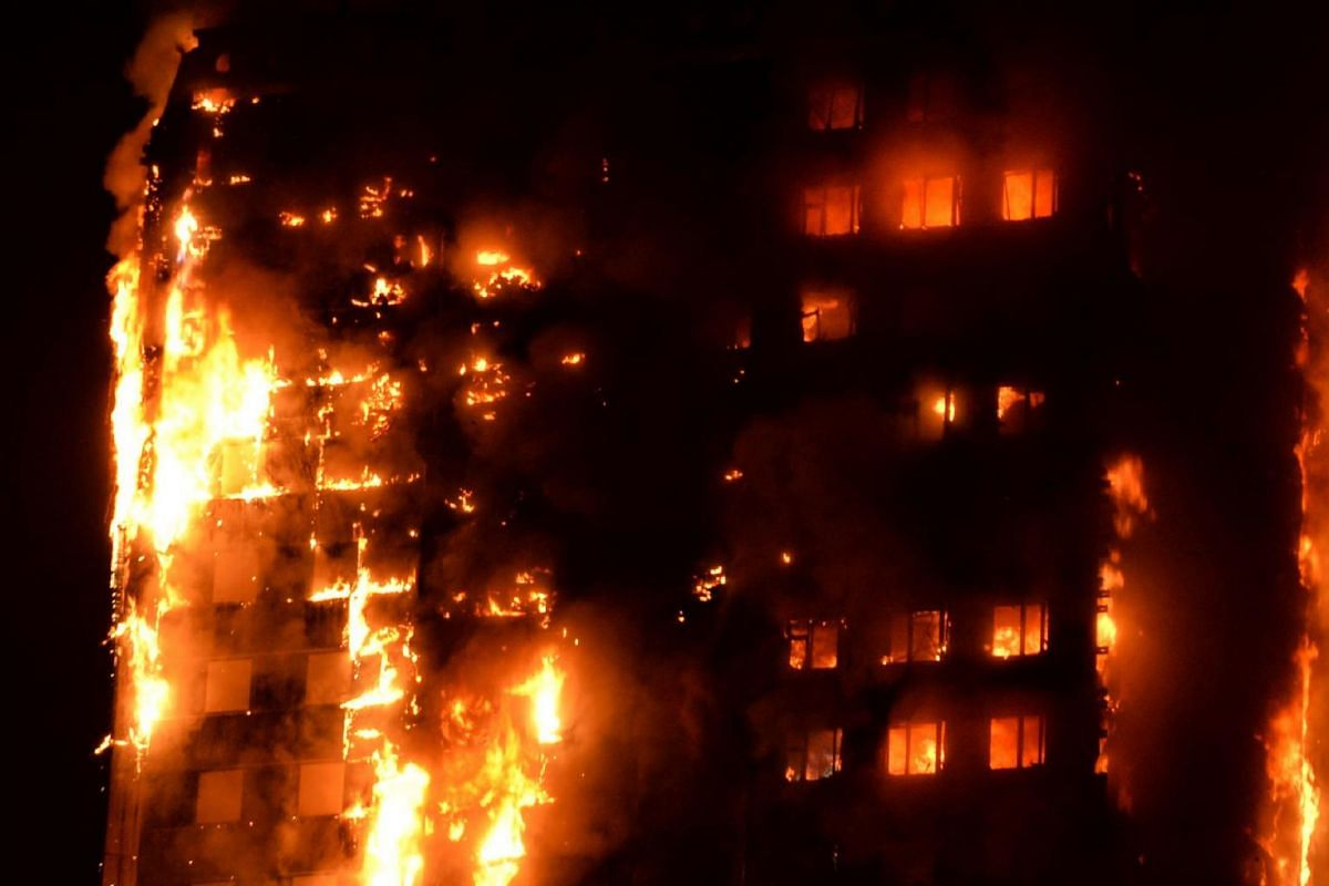 Flames engulfing a 27-storey block of flats in west London on June 14, 2017.