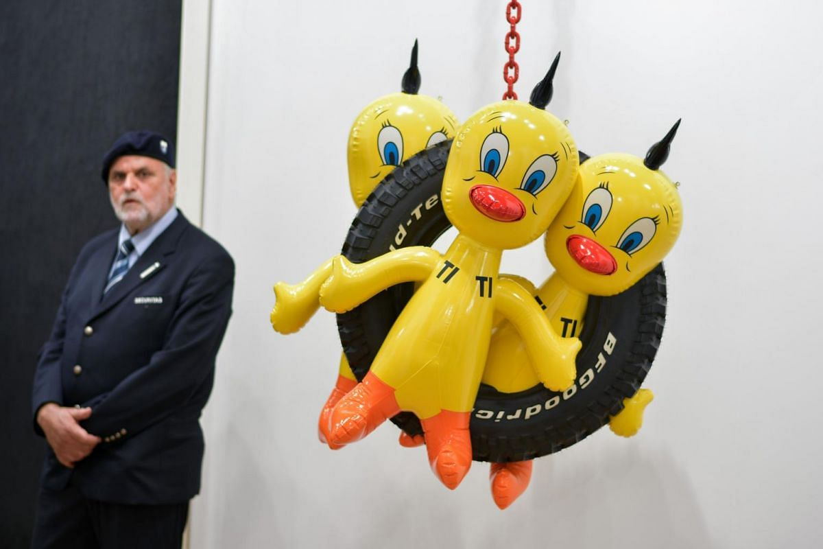 A security guard stands behind Titi Tire by US artist Jeff Koons at the Gagosian gallery's stand during the preview day of Art Basel the world's premier modern and contemporary art fair on June 13, 2017 in Basel.