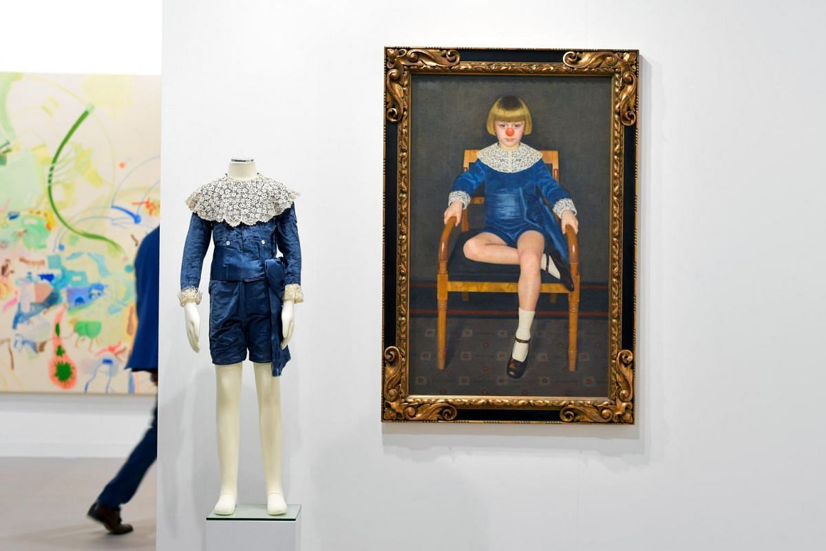 Boy With Red Nose In a Blue Velvet Dress a painting by German visual artist Hans-Peter Feldmann is displayed at 303 Gallery New York during the preview day of Art Basel the world's premier modern and contemporary art fair on June 13, 2017 in Basel.