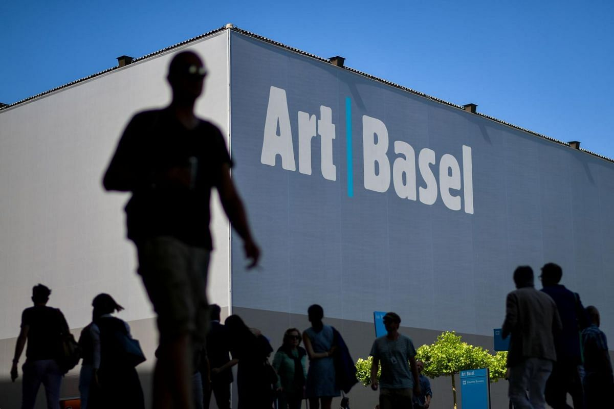 Visitors are seen at the entrance of Art Basel the world's premier modern and contemporary art fair during the preview day on June 13, 2017 in Basel.