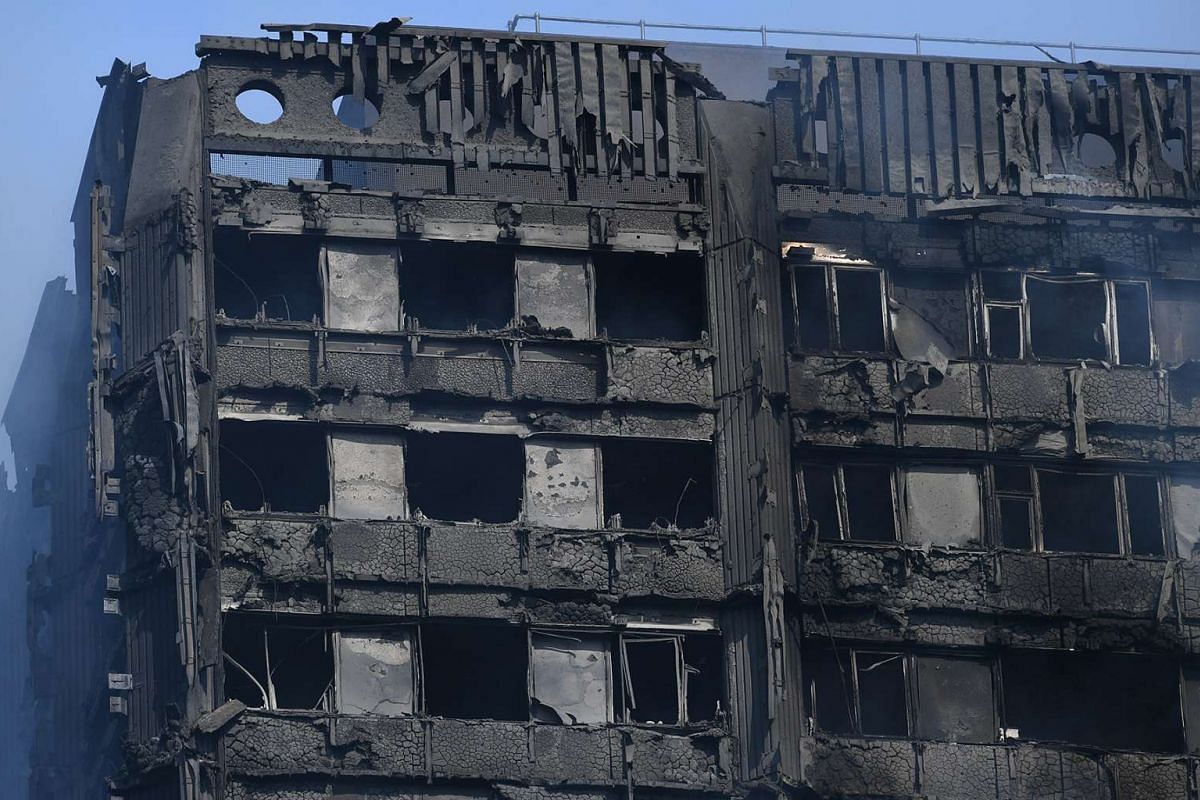 The damaged remains of a fire at Grenfell Tower, a 24-storey apartment block in North Kensington, London, Britain, June 14, 2017.  12 residents died in the fire and a number of others have been treated for a range of injuries.