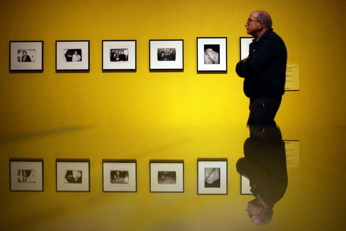 A man looks at some of the more than 200 pieces of art by Andy Warhol on exhibit in Santiago de Chile, Chile, June 14, 2017. The exhibit features some of the most iconic pieces of Andy Warhol art on pop culture and celebrity. The exhibit, at the Pala