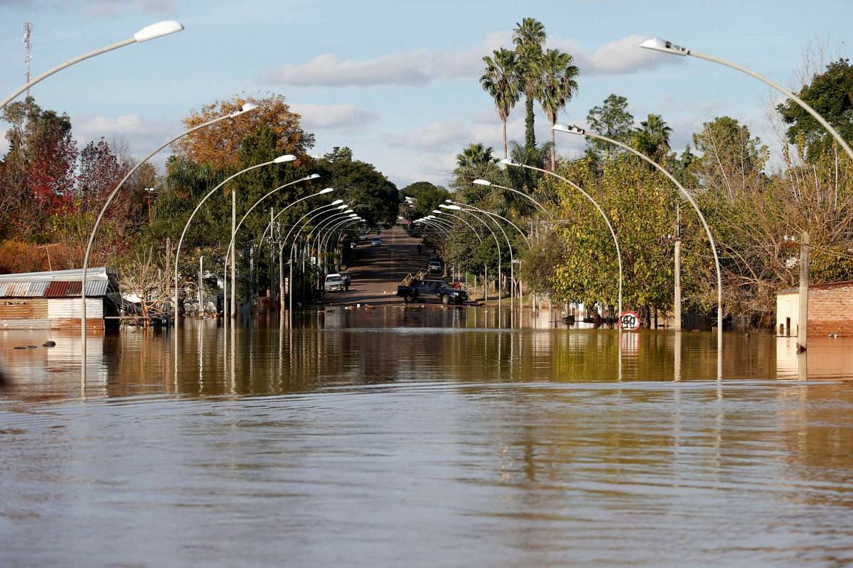 A flooded street is seen at the Uruguayan city of Salto over the Uruguay river that divides Uruguay and Argentina, June 14, 2017.