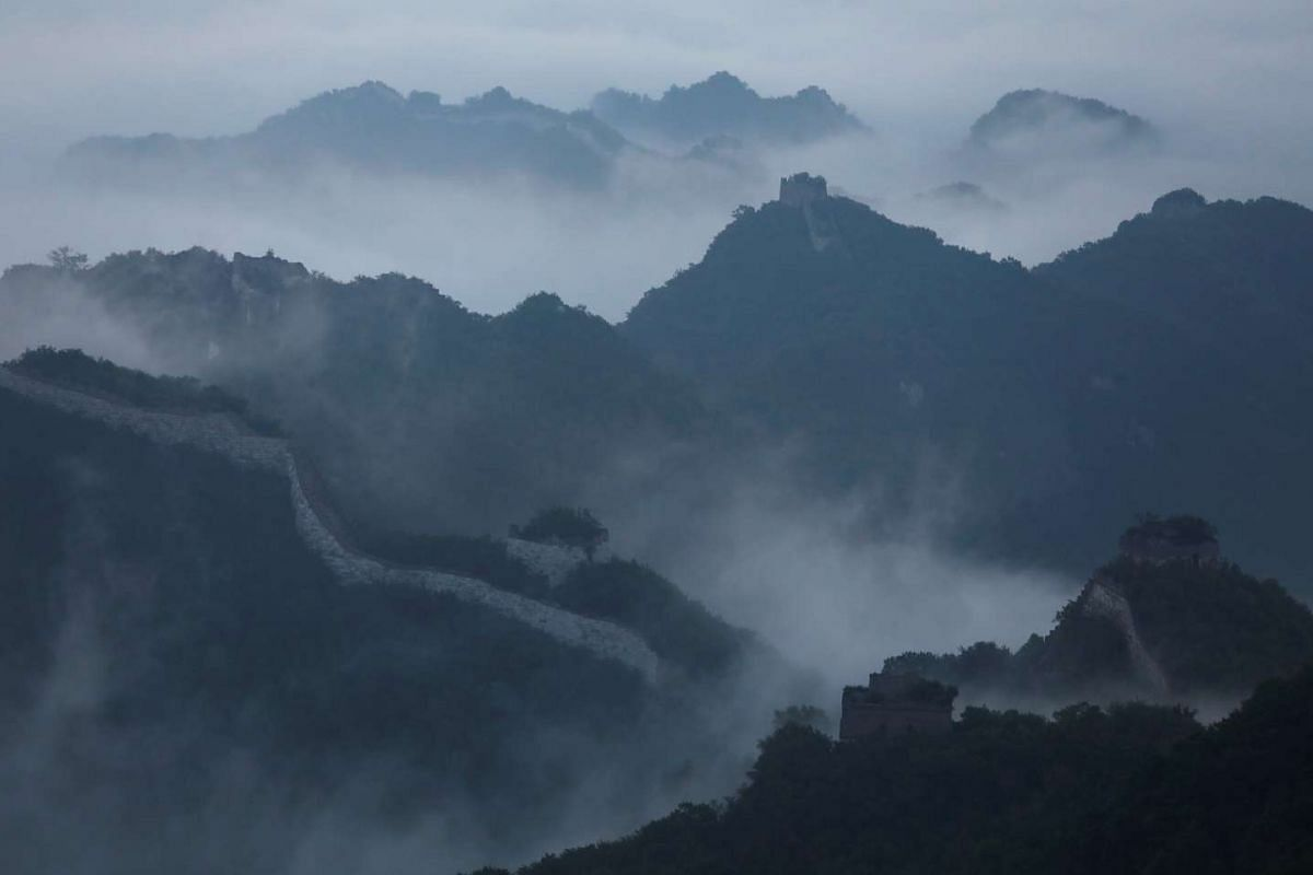 Early morning fog covering the Great Wall.
