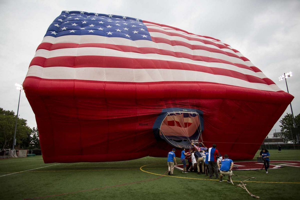 "The ""America One"" hot air balloon in the shape of the American flag is inflated for Flag Day in Hoboken, N.J., June 14, 2017."