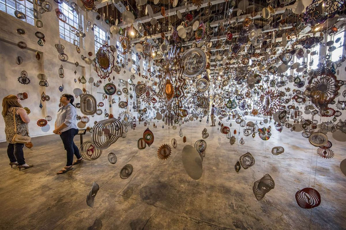 "Nick Cave's ""Kinetic Spinner Forest"" at the Massachusetts Museum of Contemporary Art in North Adams, Mass., June 10, 2017. MASS MoCA has brought its gallery space to 250,000 square feet in an expansion that also lets patrons navigate it from st"